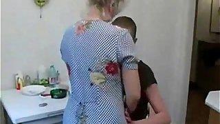 Grandson fucks his old granny in the kitchen
