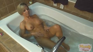 Mandy Monroe plays with her pussy in the bathtub