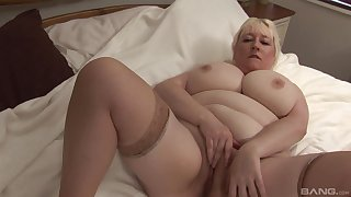 Busty mature blonde amateur gets overt and plays with her cunt