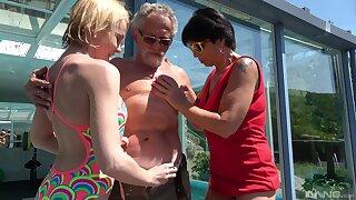 Darina and Ivana Kourilova share an old man nearby get their kicks